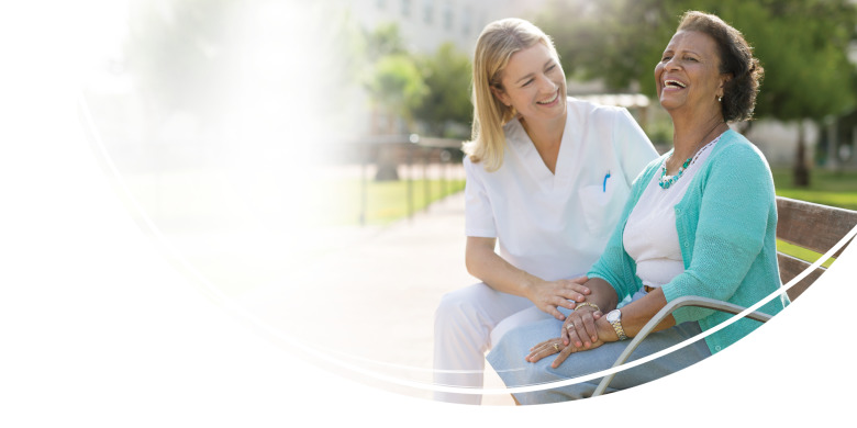 Image of Woman sitting on park bench - TENA Cares - TENA Professional